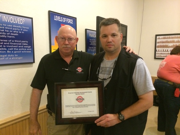 Tom Givens presenting me with the Top Gun award.