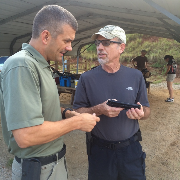 Sheriff Mark Moore and Ernest Langdon discussing Beretta 92 variants