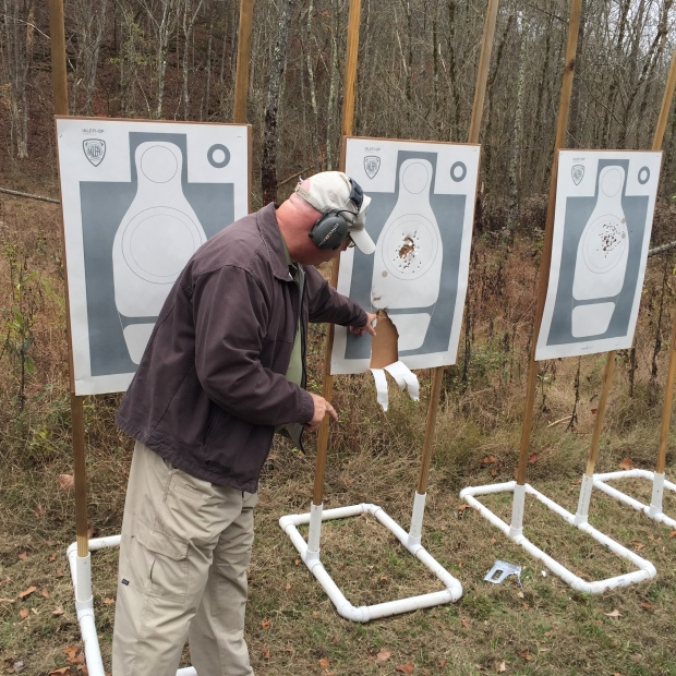 Tom Givens demonstrating what the gasses from the cylinder gap will do.  He turned the target and held the revolver along side of it and fired a shot.